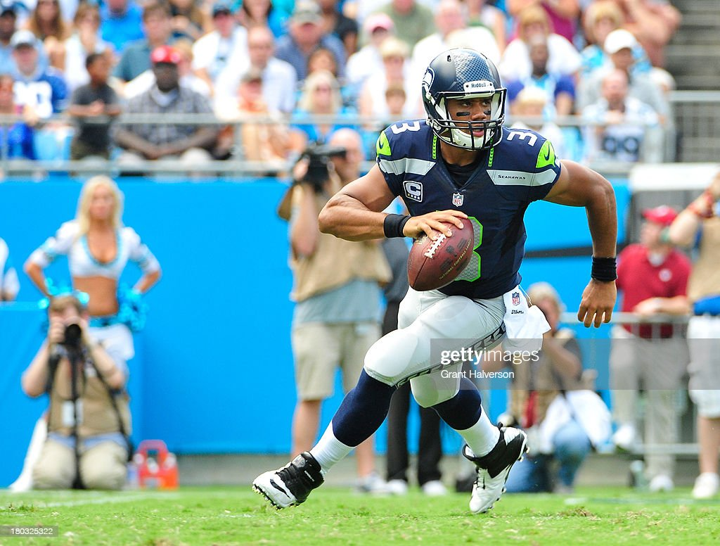 <a gi-track='captionPersonalityLinkClicked' href=/galleries/search?phrase=Russell+Wilson+-+American+Football+Quarterback&family=editorial&specificpeople=2292912 ng-click='$event.stopPropagation()'>Russell Wilson</a> #3 of the Seattle Seahawks against the Carolina Panthers during play at Bank of America Stadium on September 8, 2013 in Charlotte, North Carolina. Seattle won 12-7.