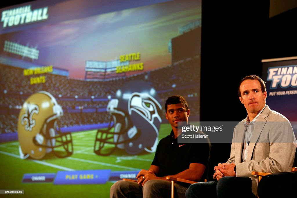 Russell Wilson of the Seattle Seahawks and Drew Brees of the New Orleans Saints address the media during the VISA Financial Football Press Event at the Media Center on January 30, 2013 in New Orleans, Louisiana.