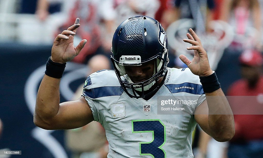 <a gi-track='captionPersonalityLinkClicked' href=/galleries/search?phrase=Russell+Wilson+-+American+Football+Quarterback&family=editorial&specificpeople=2292912 ng-click='$event.stopPropagation()'>Russell Wilson</a> #3 of the Seattle Seahawks celebrates a touchdown in the second half against the Houston Texans at Reliant Stadium on September 29, 2013 in Houston, Texas.