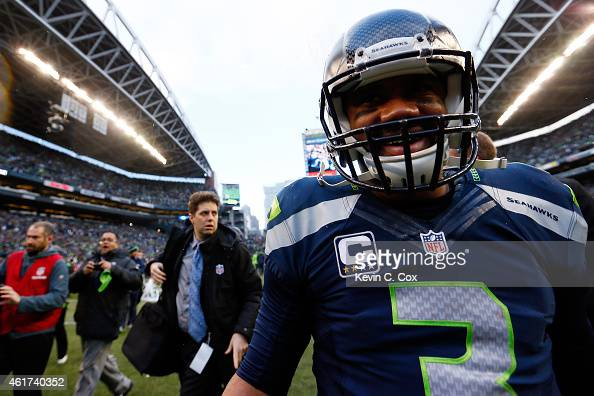 Russell Wilson of the Seattle Seahawks celebrates after the 2015 NFC Championship game against the Green Bay Packers at CenturyLink Field on January...