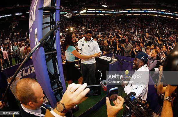 Russell Wilson of the Seattle Seahawks dances at Super Bowl XLIX Media Day Fueled by Gatorade inside US Airways Center on January 27 2015 in Phoenix...