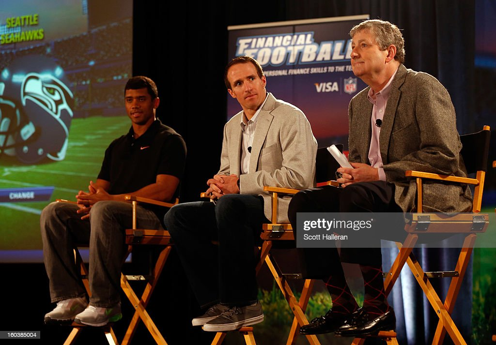 Russell Wilson of the Seattle Seahawks, Drew Brees of the New Orleans Saints and Louisiana State Treasurer John Kennedy address the media during the VISA Financial Football Press Event at the Media Center on January 30, 2013 in New Orleans, Louisiana.