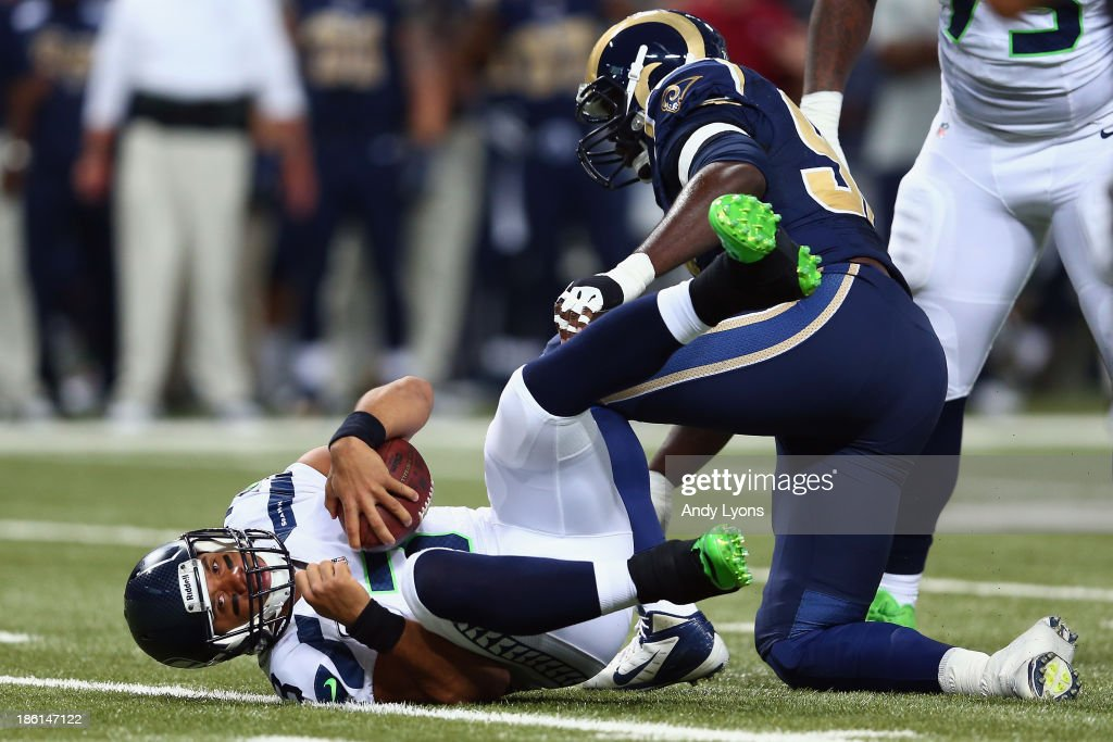 Russell Wilson #3 of the Seattle Seahawks gets sacked by William Hayes #95 the St. Louis Rams during an NFL game at Edward Jones Dome on October 28, 2013 in St Louis, Missouri.