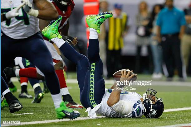 Russell Wilson of the Seattle Seahawks gets tackled for a safety against the Atlanta Falcons at the Georgia Dome on January 14 2017 in Atlanta Georgia