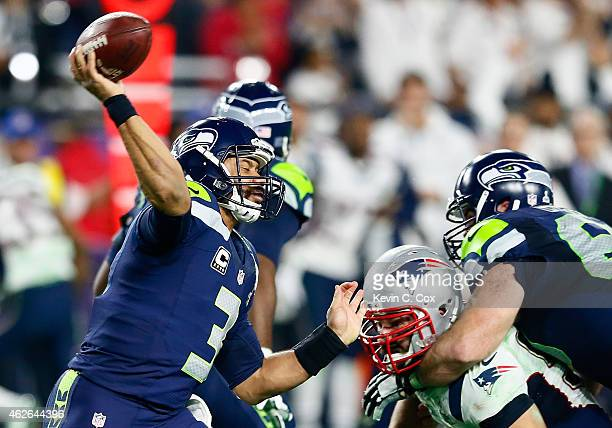 Russell Wilson of the Seattle Seahawks has a pass intercepted by Malcolm Butler of the New England Patriots late in the fourth quarter against the...