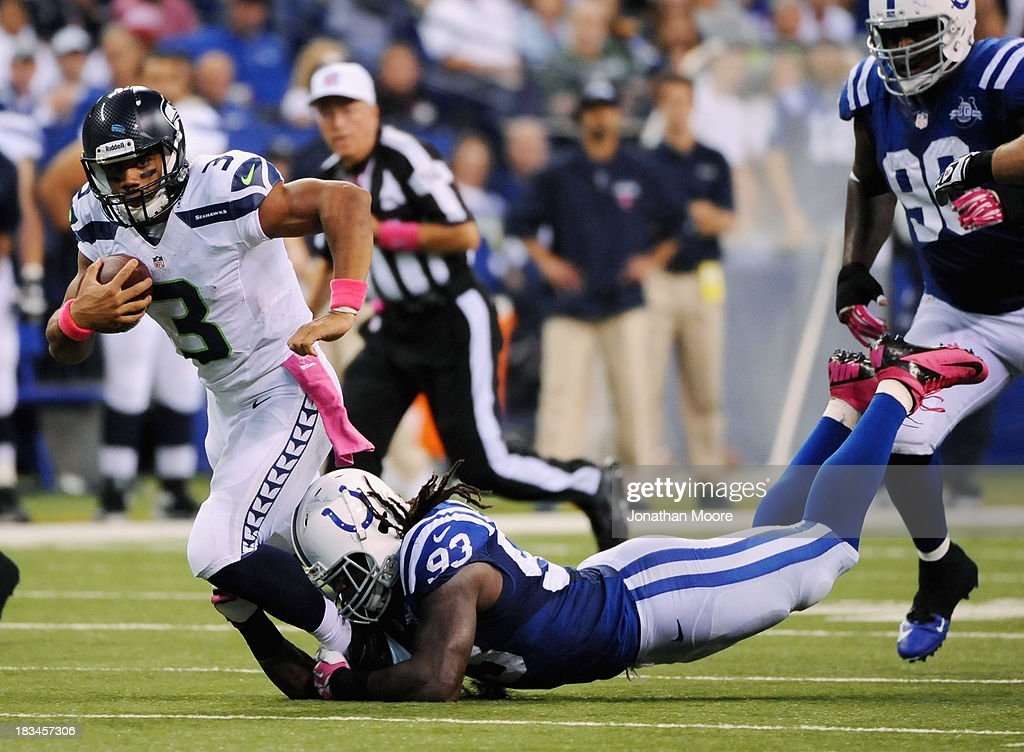 Russell Wilson #3 of the Seattle Seahawks is taken down by Erik Walden #93 of the Indianapolis Colts at Lucas Oil Stadium on October 6, 2013 in Indianapolis, Indiana.