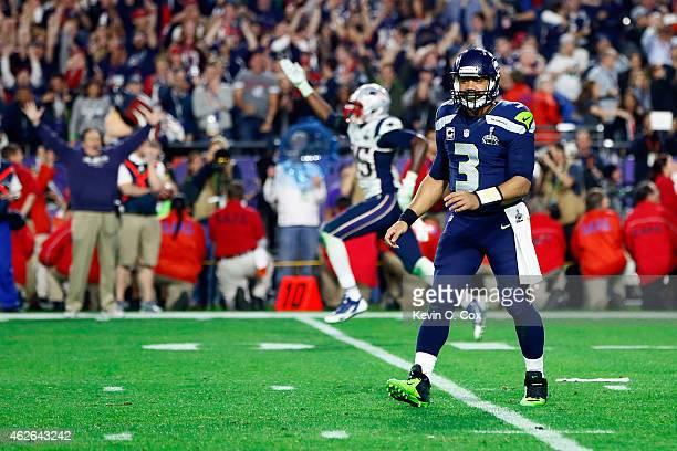 Russell Wilson of the Seattle Seahawks looks on after his pass is intercepted by Malcolm Butler of the New England Patriots late in the fourth...
