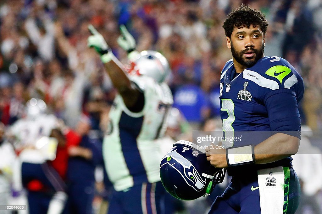 Russell Wilson #3 of the Seattle Seahawks looks on after his pass is intercepted by Malcolm Butler #21 of the New England Patriots late in the fourth quarter against the New England Patriots during Super Bowl XLIX at University of Phoenix Stadium on February 1, 2015 in Glendale, Arizona.