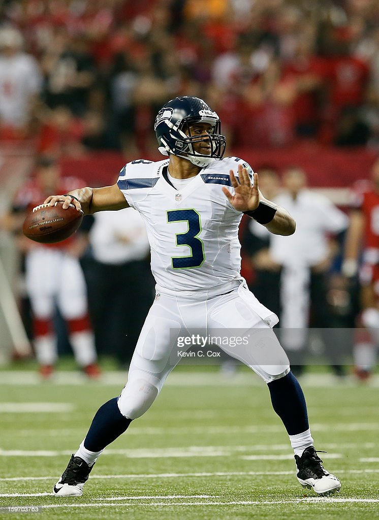 Russell Wilson #3 of the Seattle Seahawks looks to pass against the Atlanta Falcons during the NFC Divisional Playoff Game at Georgia Dome on January 13, 2013 in Atlanta, Georgia.