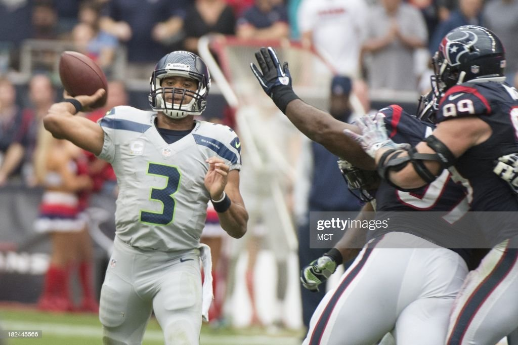 Russell Wilson (3) of the Seattle Seahawks makes a pass against the Houston Texans in the second half of a 23-20 Seattle overtime victory on Sunday, September 29, 2013, in Houston, Texas.