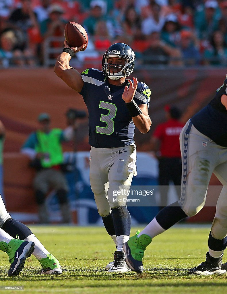 Russell Wilson #3 of the Seattle Seahawks passes during a game against the Miami Dolphins at Sun Life Stadium on November 25, 2012 in Miami Gardens, Florida.