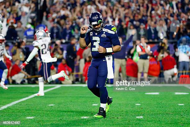 Russell Wilson of the Seattle Seahawks reacts after an interception in the fourth quarter against the New England Patriots during Super Bowl XLIX at...