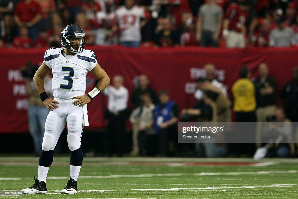 Russell Wilson #3 of the Seattle Seahawks reacts during the NFC Divisional Playoff Game against the Atlanta Falcons at Georgia Dome on January 13, 2013 in Atlanta, Georgia.