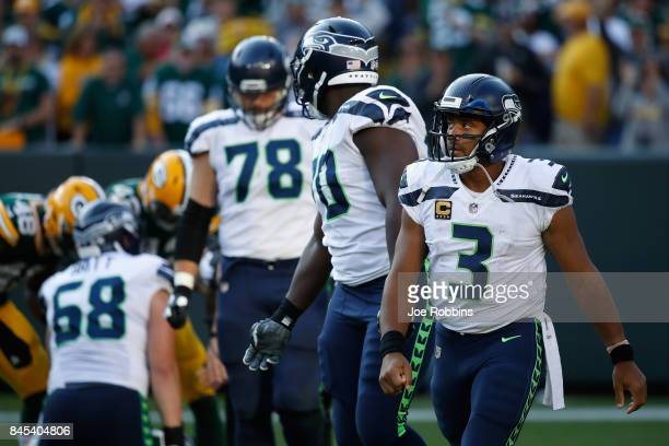 Russell Wilson of the Seattle Seahawks reacts during the second half against the Green Bay Packers at Lambeau Field on September 10 2017 in Green Bay...