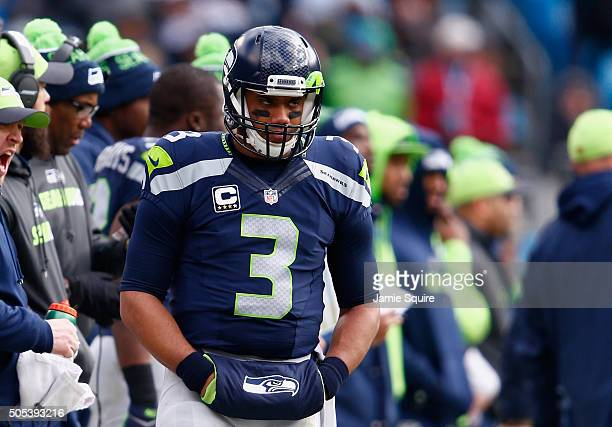 Russell Wilson of the Seattle Seahawks reacts from the sideline against the Carolina Panthers in the 2nd quarter during the NFC Divisional Playoff...