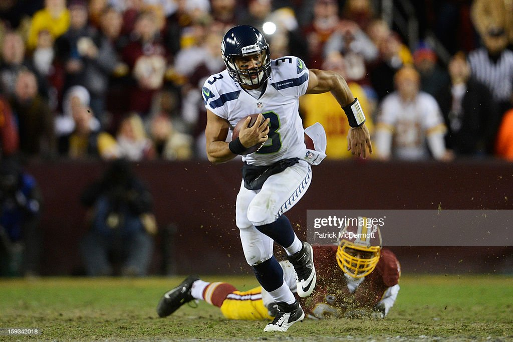Russell Wilson #3 of the Seattle Seahawks runs the ball against the Washington Redskins during the NFC Wild Card Playoff Game at FedExField on January 6, 2013 in Landover, Maryland.