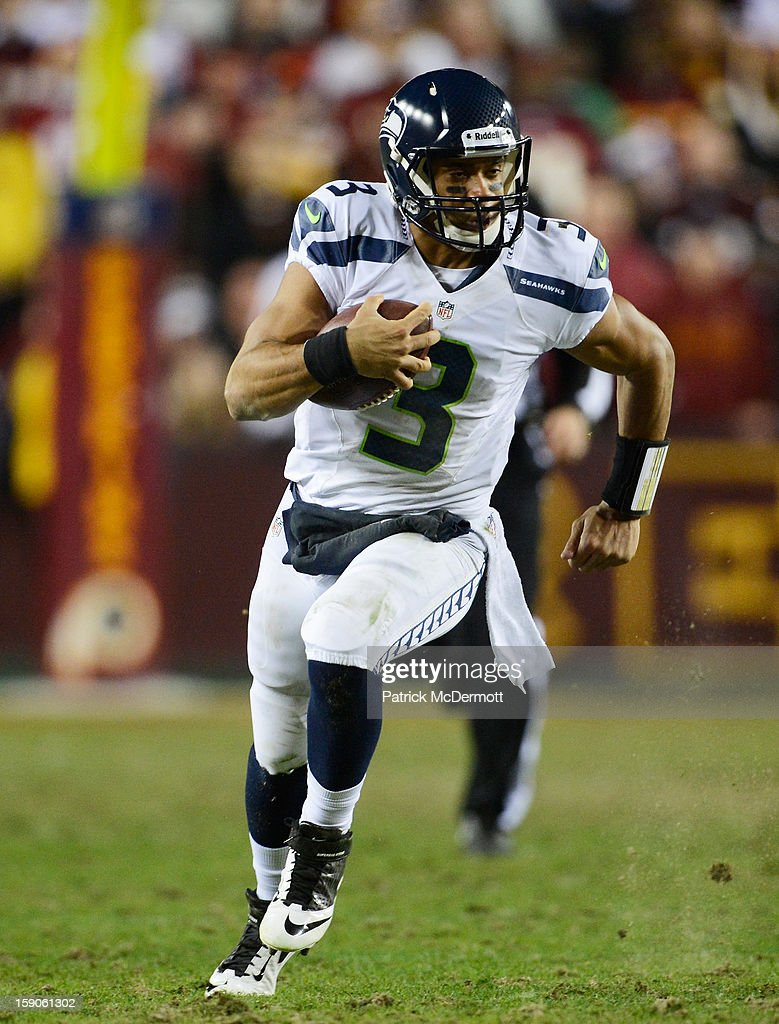 <a gi-track='captionPersonalityLinkClicked' href=/galleries/search?phrase=Russell+Wilson+-+Football-Spieler+-+Quarterback&family=editorial&specificpeople=2292912 ng-click='$event.stopPropagation()'>Russell Wilson</a> #3 of the Seattle Seahawks runs the ball during their NFC Wild Card Playoff Game against the Washington Redskins at FedExField on January 6, 2013 in Landover, Maryland.