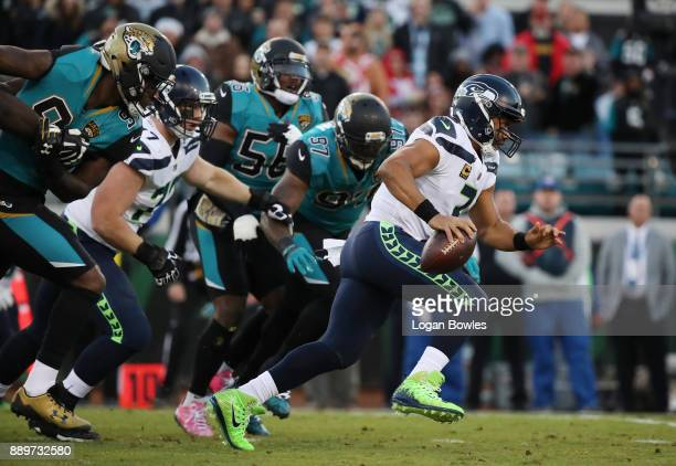 Russell Wilson of the Seattle Seahawks runs with the football during the first half of their game against the Jacksonville Jaguars at EverBank Field...