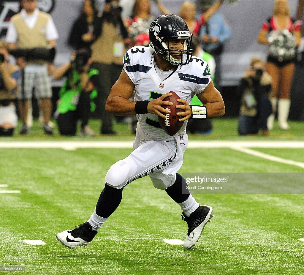 Russell Wilson #3 of the Seattle Seahawks scrambles against the Atlanta Falcons during the NFC Divisional Playoff Game at the Georgia Dome on January 13, 2013 in Atlanta, Georgia