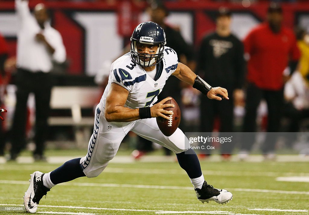 Russell Wilson #3 of the Seattle Seahawks scrambles against the Atlanta Falcons during the NFC Divisional Playoff Game at Georgia Dome on January 13, 2013 in Atlanta, Georgia.