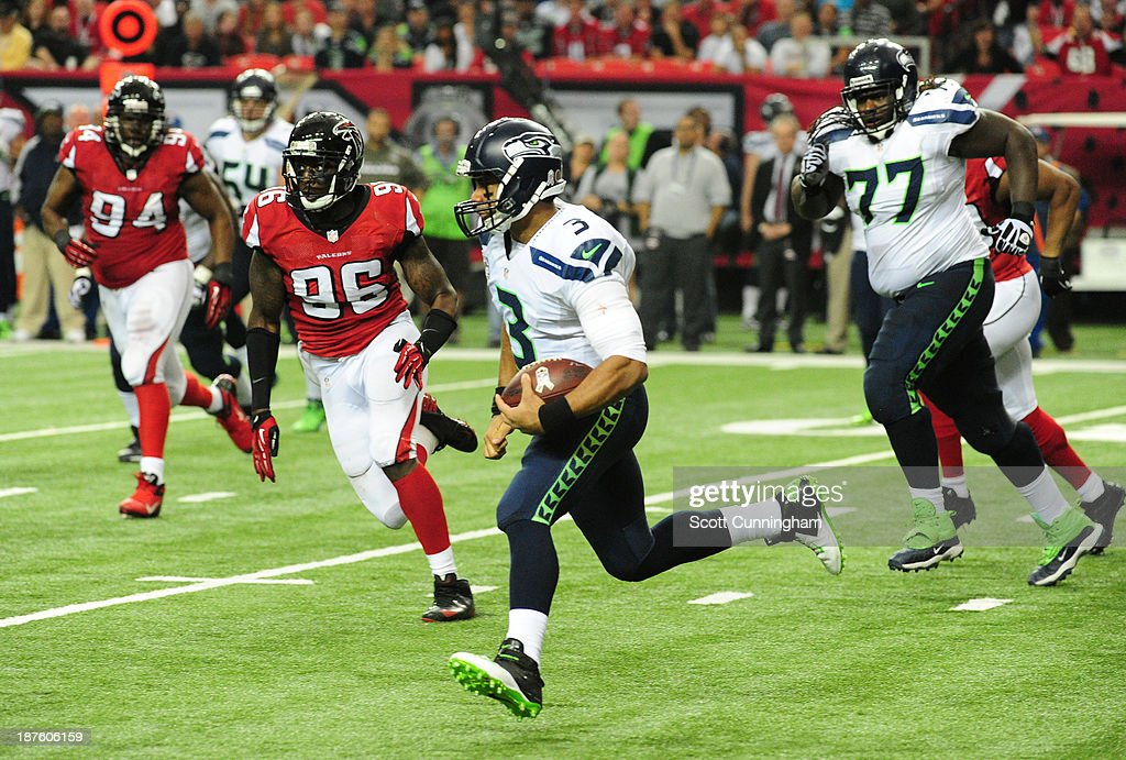 <a gi-track='captionPersonalityLinkClicked' href=/galleries/search?phrase=Russell+Wilson+-+American+Football+Quarterback&family=editorial&specificpeople=2292912 ng-click='$event.stopPropagation()'>Russell Wilson</a> #3 of the Seattle Seahawks scrambles against the Atlanta Falcons at the Georgia Dome on November 10, 2013 in Atlanta, Georgia.