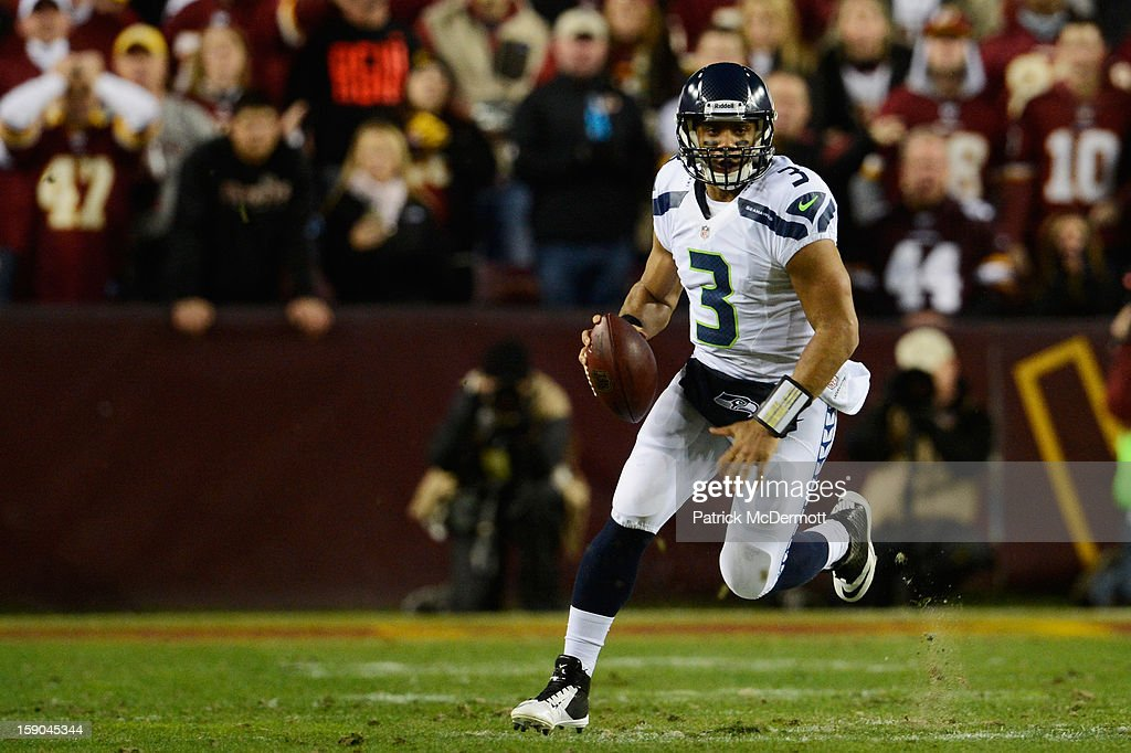 Russell Wilson #3 of the Seattle Seahawks scrambles against the Washington Redskins during the NFC Wild Card Playoff Game at FedExField on January 6, 2013 in Landover, Maryland.