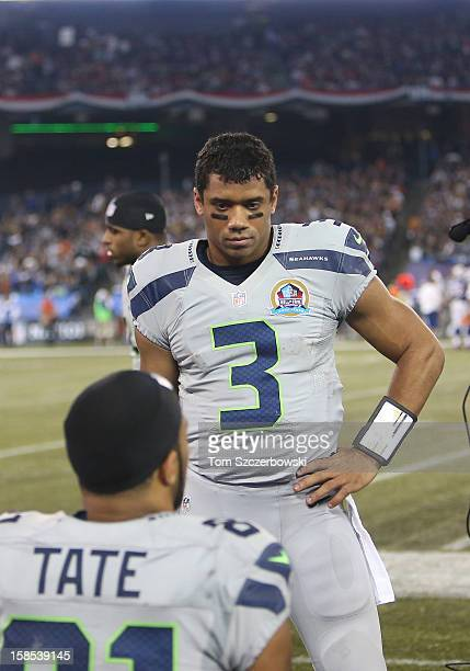 Russell Wilson of the Seattle Seahawks talks to Golden Tate on the bench during an NFL game against the Buffalo Bills at Rogers Centre on December 16...