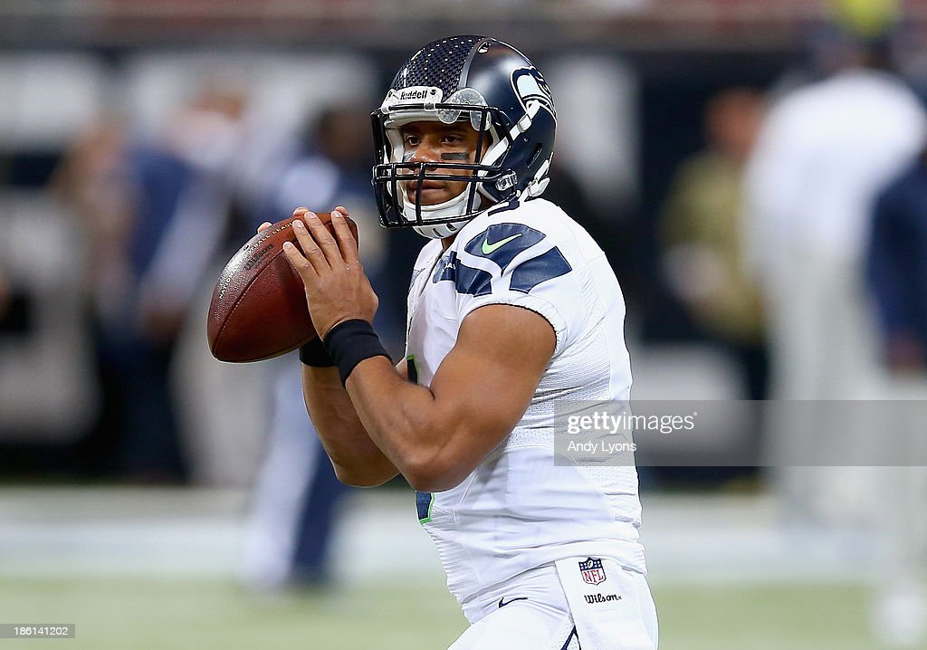Russell Wilson #3 of the Seattle Seahawks throws a pass before the NFL game against the St. Louis Rams at Edward Jones Dome on October 28, 2013 in St Louis, Missouri.