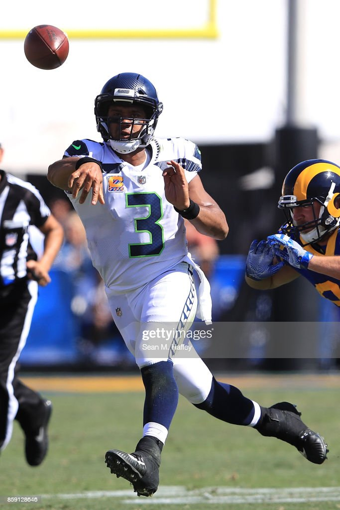 Russell Wilson #3 of the Seattle Seahawks throws a pass during the game against the Los Angeles Rams at the Los Angeles Memorial Coliseum on October 8, 2017 in Los Angeles, California.