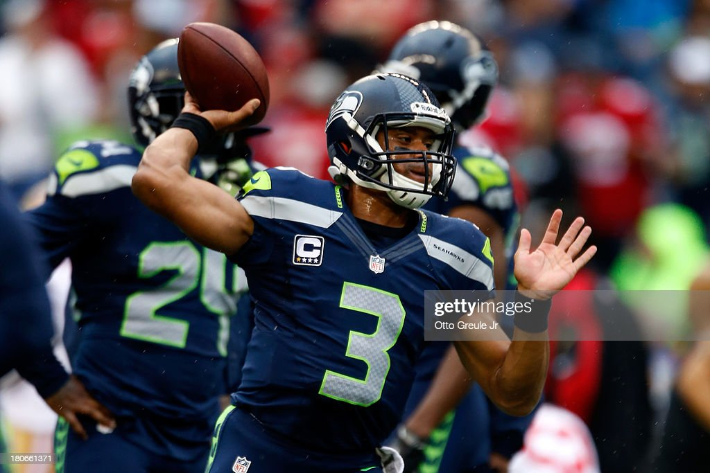 <a gi-track='captionPersonalityLinkClicked' href=/galleries/search?phrase=Russell+Wilson+-+American+Football+Quarterback&family=editorial&specificpeople=2292912 ng-click='$event.stopPropagation()'>Russell Wilson</a> #3 of the Seattle Seahawks warms up prior to their game against the San Francisco 49ers at Qwest Field on September 15, 2013 in Seattle, Washington.