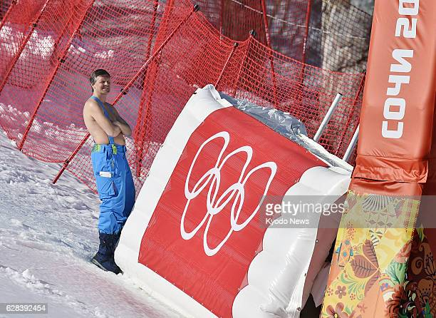 SOCHI Russia A Winter Olympics staff member naked to the waist watches the women's alpine skiing Super G event in Sochi Russia on Feb 15 as the warm...