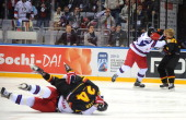 Russia and Germany' players fight during a quarterfinal game of the IIHF U18 International Ice Hockey World Championship in Sochi on April 25 2013...