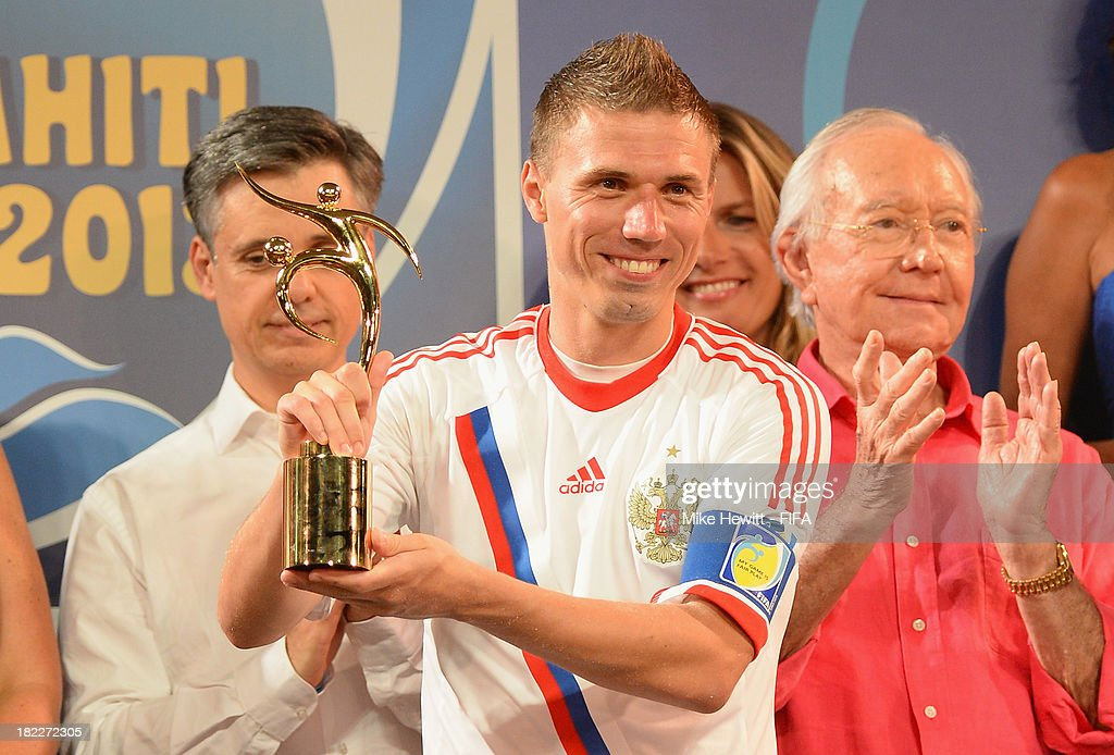 Russia captain Ilya Leonov holds aloft the Fair Play trophy the FIFA Beach Soccer World Cup Tahiti 2013 Final between Spain and Russiai at the Tahua To'ata Stadium on September 28, 2013 in Papeete, French Polynesia.
