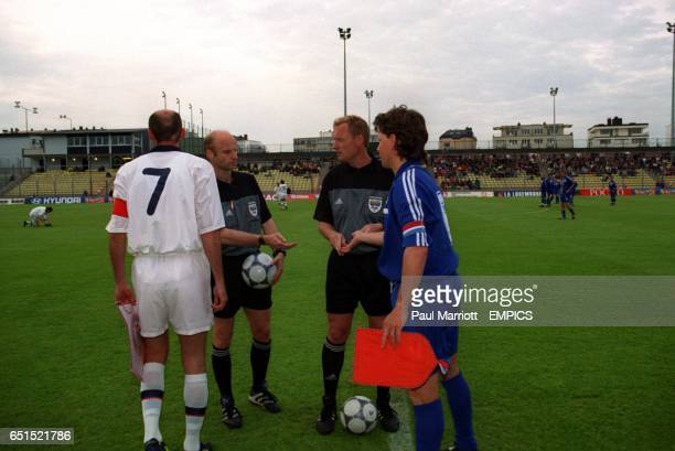 Russia captain Victor Onopko and Luxembourg captain Jeff Saibene at the coin toss with referee Jon Skjervold