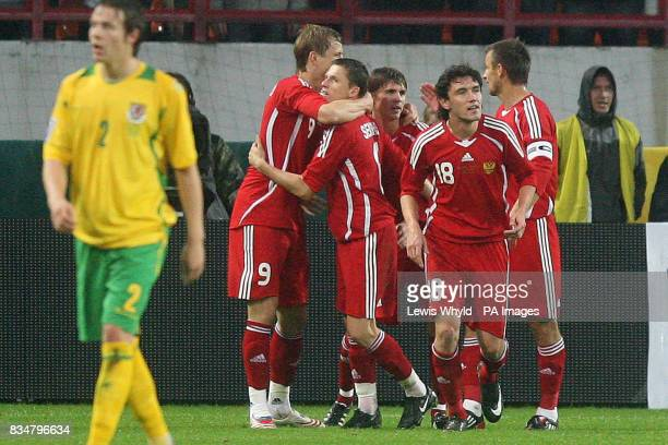 Russia celebrate after Roman Pavlyuchenko scored during the World Cup Qualifying match at the Lokomotiv Stadium Moscow Russia