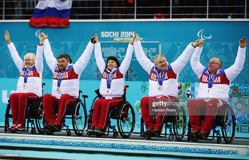 Russia celebrate after winning silver in the match between Russia and Canada on day eight of Sochi 2014 Paralympic Winter Games at the Ice Cube Curling Center on March 15, 2014 in Sochi, Russia.