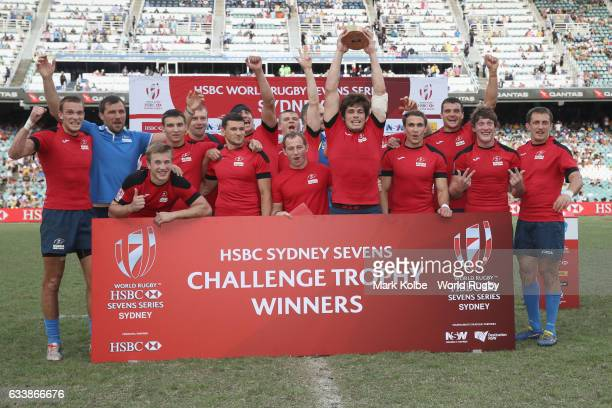 Russia celebrate with the Challenge trophy after victory over France in the Challenge Trophy final match in the 2017 HSBC Sydney Sevens at Allianz...