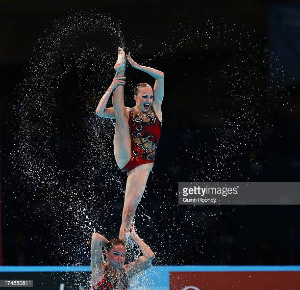 Russia compete during the Synchronized Swimming Free Combination Final on day eight of the 15th FINA World Championships at Palau Sant Jordi on July...