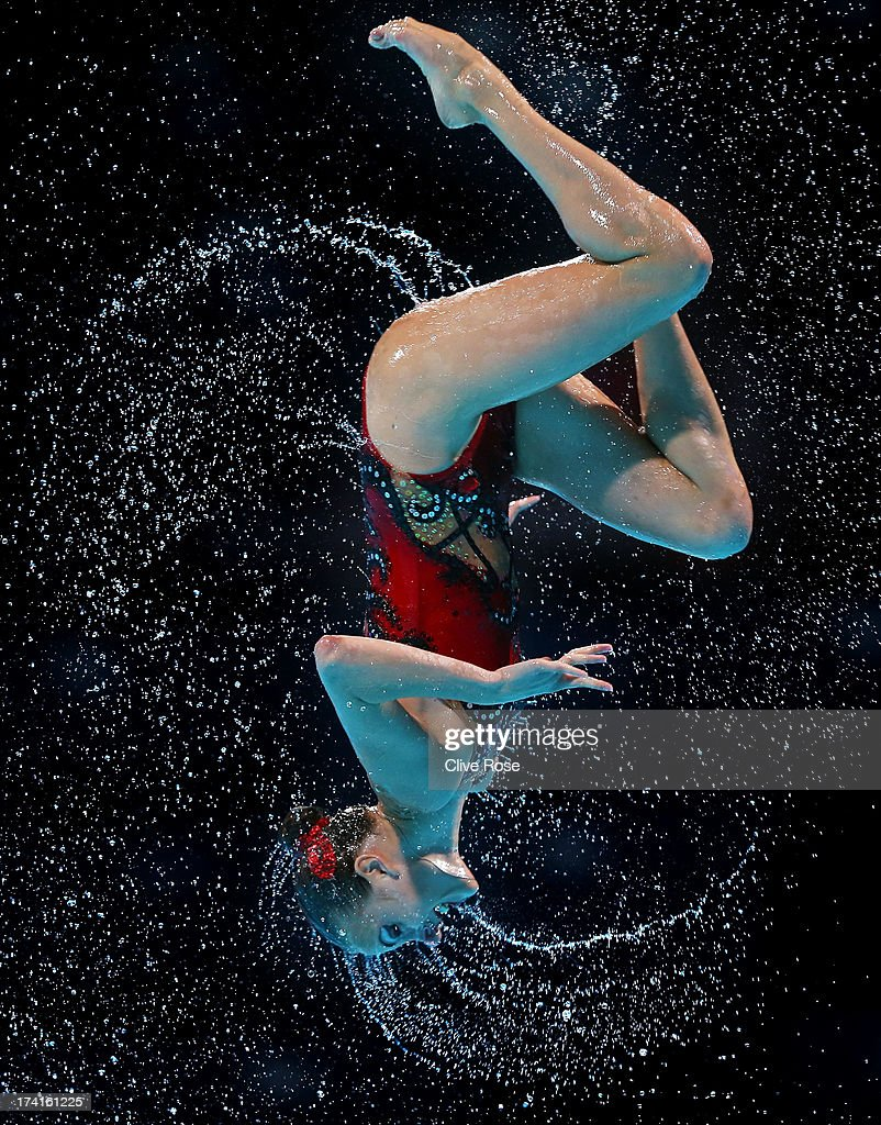Russia compete in the Synchronized Swimming Free Combination preliminary round on day two of the 15th FINA World Championships at Palau Sant Jordi on...