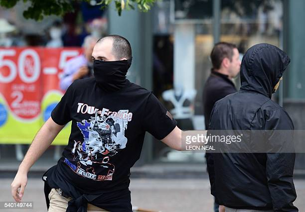A Russia football fan taunts England fans sitting in a cafe in the city of Lille on June 14 the day before the Euro 2016 group B match Russia vs...
