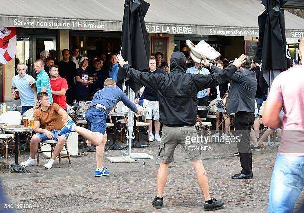 A Russia football supporter lobs a chair towards England fans sitting in a cafe in the northern city of Lille on June 14 the day before the Euro 2016...