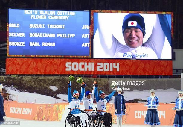 SOCHI Russia Gold medalist Takeshi Suzuki of Japan celebrates with silver medalist Philipp Bonadimann and bronze medalist Roman Rabl both of Austria...
