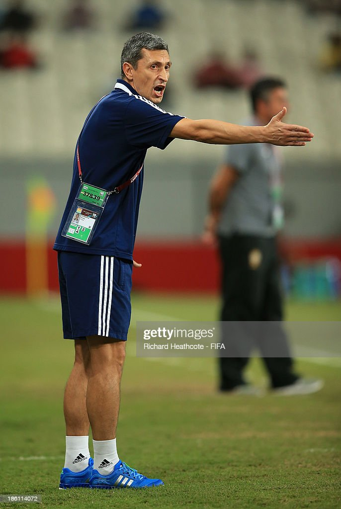 Russia head coach Dmitry Khomukha gives instructions during the FIFA U-17 World Cup UAE 2013 Round of 16 match between Brazil and Russia at the Mohamed Bin Zayed Stadium on October 28, 2013 in Abu Dhabi, United Arab Emirates.