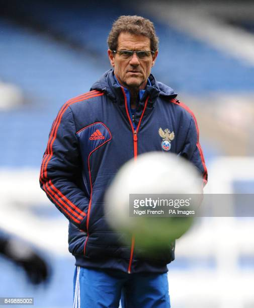 Russia Head Coach Fabio Capello watches his players during a training session at Stamford Bridge London