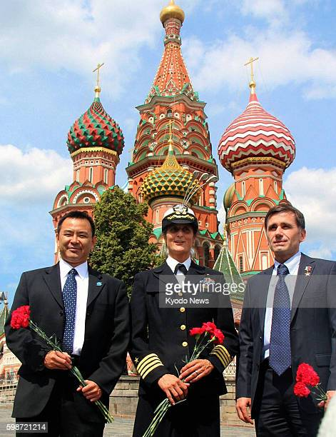 MOSCOW Russia Japanese astronaut Akihiko Hoshide US astronaut Sunita Williams and Russian cosmonaut Yuri Malenchenko pose for photos at Red Square in...