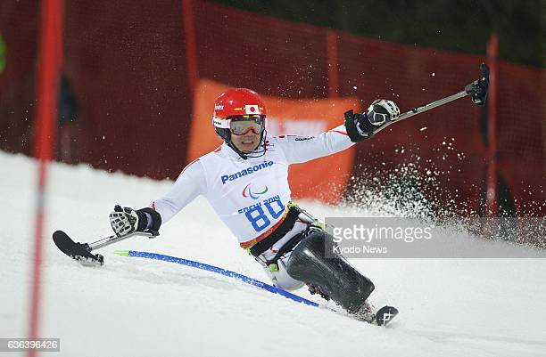 SOCHI Russia Japan's Takeshi Suzuki skis down the slope during his second run en route to victory in the men's sitting slalom event at the Paralympic...