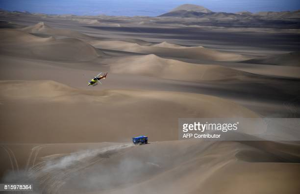 TOPSHOT Russia Kamaz's driver Dmitry Sotnikov codrivers Ruslan Akhmadeev and Ilnur Mustafin compete during the Stage 9 of the Silk Way 2017 between...