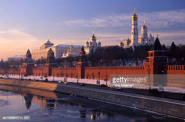 Russia, Moscow, Church of Archangel Michael and Assumption Cathedral behind Kremlin Wall at sunrise
