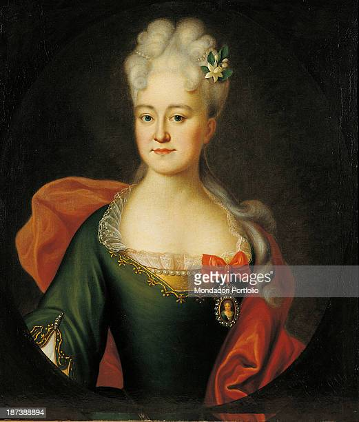Russia Moscow Gosudarstvennyj Istoriceskij Muzej All Portrait of the woman wearing a green dress trimmed with laces and bow on the neckline and a red...