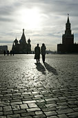Russia, Moscow, Red Square, silhouette of couple walking